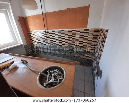 A ruined and deteriorating kitchen in an old, derelict apartment in Zagreb, Croatia Royalty-Free Stock Photo #1937068267