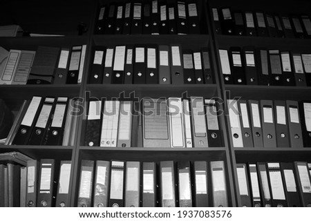 high shelves with folders. Bottom-up view