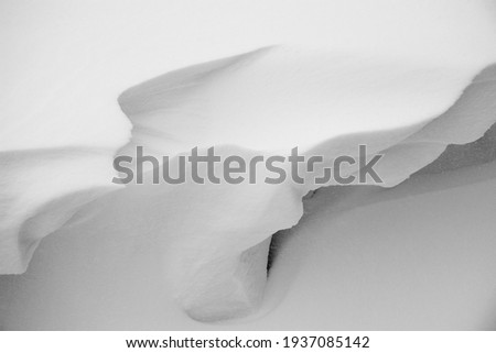 close up snow dunes lines and shapes, detail winter landscape. beauty in nature, shapes in snow dune. Extreme environment. Adventure winter background. Abstract textures