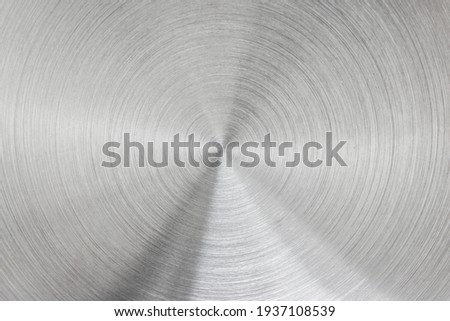 Metallic background of brushed chrome stainless steel surface with circular shapes. Royalty-Free Stock Photo #1937108539