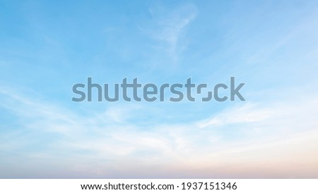 The sky has the light of the sun, the sky is blue, there are small and large clouds alternating and moving slowly, with the sunlight passing, creating a miraculous abstract shape, a hot day. Royalty-Free Stock Photo #1937151346
