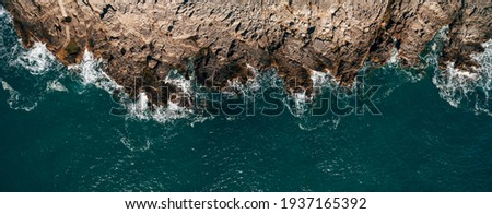 Aerial view of sea waves and fantastic Rocky coast, Montenegro Royalty-Free Stock Photo #1937165392