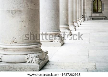 Row of white marble columns. Greek marble pillars detail Royalty-Free Stock Photo #1937282938