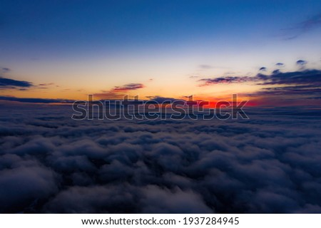 Aerial sunset view over the Blue Ridge Mountains from the cockpit of a private aircraft. Sky with clouds. Sky background Royalty-Free Stock Photo #1937284945