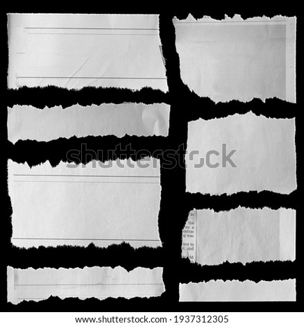 Eight pieces of torn newspaper on black background Royalty-Free Stock Photo #1937312305