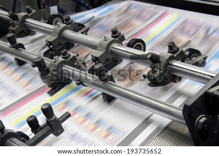 The equipment for a press in a modern printing house Royalty-Free Stock Photo #193735652