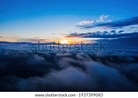 Sunset on blue sky. Blue sky with some clouds. Royalty-Free Stock Photo #1937399083