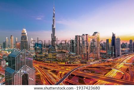 Dubai city center skyline - amazing cityscape with luxury skyscrapers at sunrise, United Arab Emirates Royalty-Free Stock Photo #1937423680