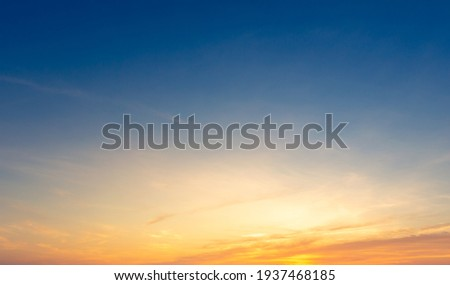 Beautiful Vivid sky painted by the sun leaving bright golden shades.Dense clouds in twilight sky in winter evening.Image of cloud sky on evening time.Evening Vivid sky with clouds. Royalty-Free Stock Photo #1937468185
