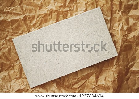 White business card flatlay on brown parchment paper background, luxury branding flat lay and brand identity design for mockups