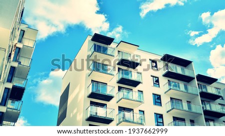 Apartment residential house and home facade architecture and outdoor facilities. Blue sky on the background. Sunlight. Retro filter. Royalty-Free Stock Photo #1937662999