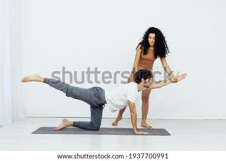 Man engaged in yoga with asana sports gymnastics fitness instructor