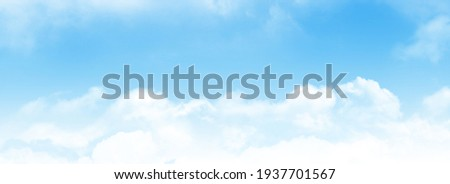 Blue sky with light clouds. Wide summer sky backdrop
