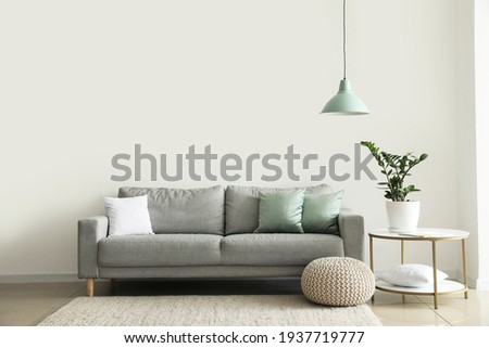 Interior of modern room with comfortable sofa Royalty-Free Stock Photo #1937719777