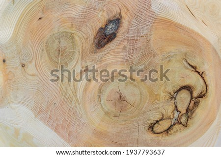 Node on a wooden surface. Several knot. The colors of the wood pattern are brown, yellow, orange. Royalty-Free Stock Photo #1937793637