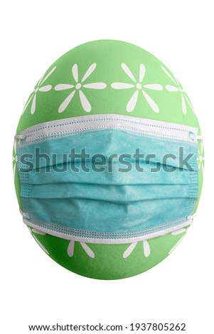 Large picture of an isolated easter egg with floral pattern and mask.