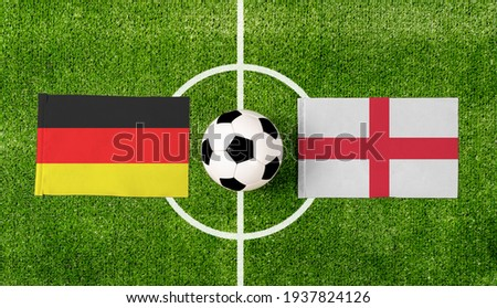 Top view ball with Germany vs. England flags match on green soccer field. Royalty-Free Stock Photo #1937824126