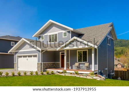 A perfect neighbourhood. Houses in suburb at Summer in the north America. Luxury houses with nice landscape. Royalty-Free Stock Photo #1937913955