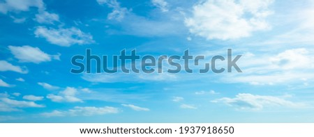 Blue sky and white clouds floated in the sky on a clear day with warm sunshine combined with cool breeze blowing against the body resulting in a miraculous refreshing like paradise Royalty-Free Stock Photo #1937918650