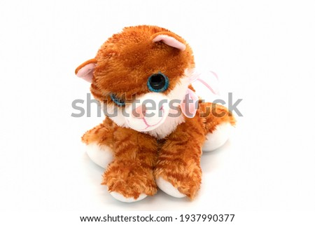 Funny toy cat isolated on white