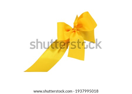 Decorative yellow ribbon and bow cut out and isolated on white background Royalty-Free Stock Photo #1937995018