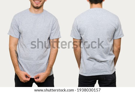 Latin young man in his 30s wearing a gray casual t-shirt. Front and rear view of a mock up template for a t-shirt design print  Royalty-Free Stock Photo #1938030157