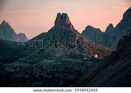 Dolomites mountains during sunrise, sunset, unbelievable peaks in nice weather conditions and colorful scene. Amazing summer nature with mood and light.  Royalty-Free Stock Photo #1938042469
