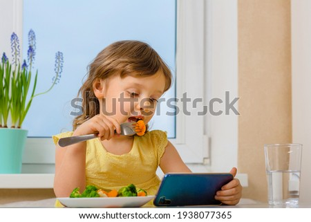 The child dictates his own rules and eats broccoli only with cartoons. Organic cabbage and food on a plate. problems with nutrition in preschool children