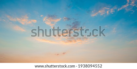 Sunrise clear blue sky with glowing pink clouds at sunset.Blue orange cloudscape. Sunset Royalty-Free Stock Photo #1938094552