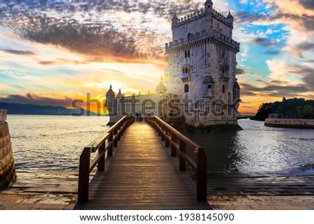 Torre de Belem (Belem tower) over sunset - famous landmark of Lisbon , Portugal Royalty-Free Stock Photo #1938145090