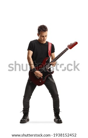 Full length portrait of a guy playing an electric guitar isolated on white background Royalty-Free Stock Photo #1938152452