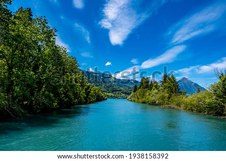 River and mountains with blue sky - Interlaken, Switzerland Royalty-Free Stock Photo #1938158392
