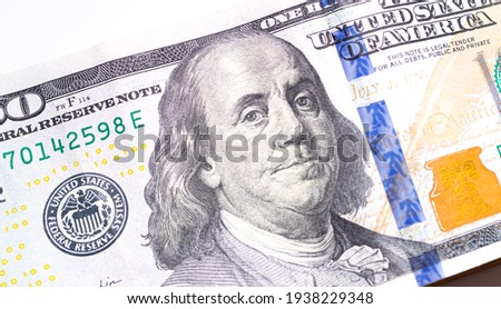 A Stack of American dollars isolated on white background. The new hundred-dollar bill is on top of the other banknotes. Close up photo and Flat view.  Royalty-Free Stock Photo #1938229348