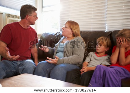 Family Sitting On Sofa With Parents Arguing #193827614