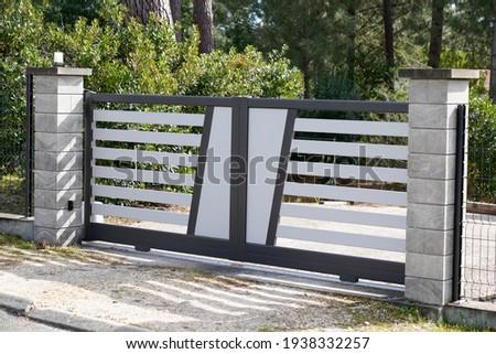 Aluminum sliding modern design grey white portal of suburb garden door slide house Royalty-Free Stock Photo #1938332257