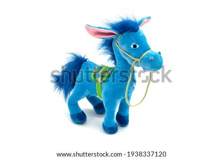 Blue fluffy horse horse toy isolated on white