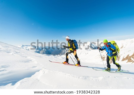 Ski mountaineers in action on the Italian Alps Royalty-Free Stock Photo #1938342328