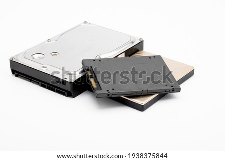Hard disk and ssd disk (solid state drive) on white background , size comparison of hard disk