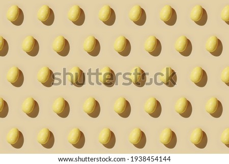Easter egg pattern in yellow. Happy Easter. Minimal concept. Flat lay. Top view.