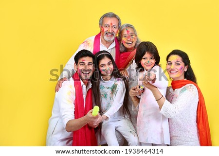 Family celebrating holi in india with full of happiness