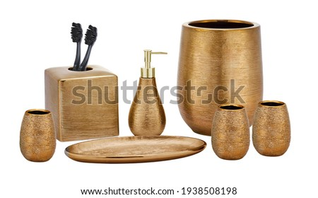 Set of accessories for bath and personal hygiene on white background, Beautiful hygiene set, Golden Bath Accessories Royalty-Free Stock Photo #1938508198