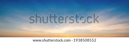 The morning sky looked like a bright golden sky. The sunrise is decorated with clouds in various shapes. Looks beautiful. Royalty-Free Stock Photo #1938508552