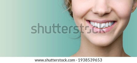 Beautiful smile of young woman with healthy white teeth Royalty-Free Stock Photo #1938539653