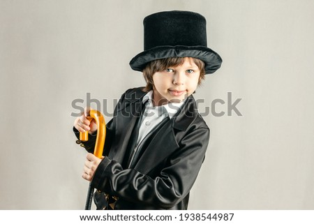 Young six year old boy wearing black suit. Cosplay, Retro party or Halloween costume rental concept Royalty-Free Stock Photo #1938544987