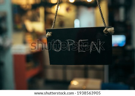 open sign board hanging on the cafe or restaurant door