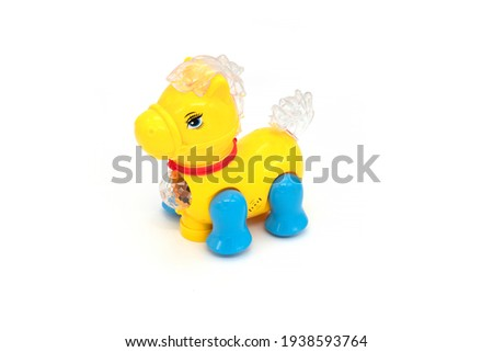 Plastic yellow toy horse isolated on white background.