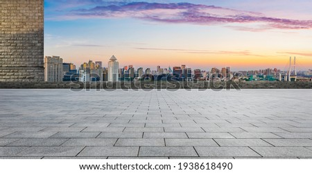 Empty square floor and Shanghai skyline with buildings at dusk,China.High angle view. Royalty-Free Stock Photo #1938618490