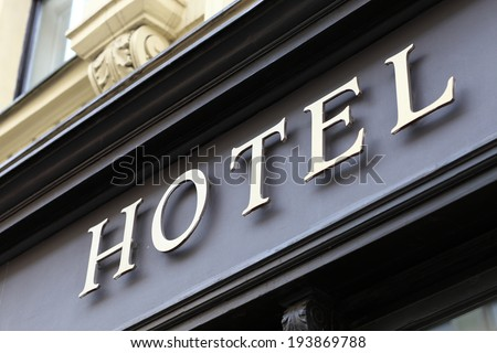 The metallic hotel sign on the wall