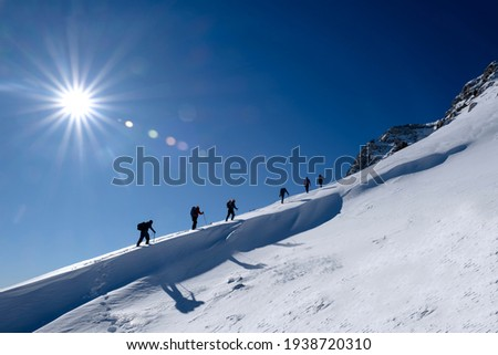 mountaineering sports and climbing tracks of the mountaineering team Royalty-Free Stock Photo #1938720310