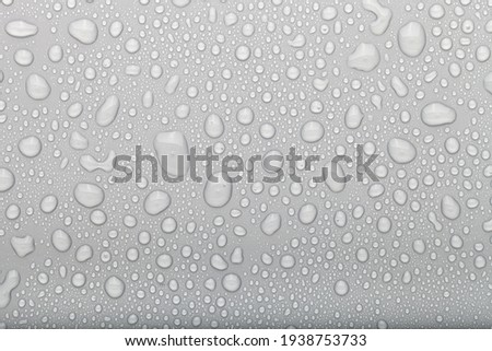 Drops of water on a color background. Selective focus. Gray. Royalty-Free Stock Photo #1938753733